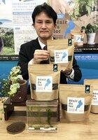 長浜市の建設会社が開発した琵琶湖の水草を原料にした堆肥(滋賀県庁)
