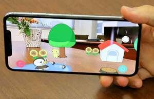 スマホの画面に映し出された現実の空間でアニメが動き天気を表現するアプリ「お天気JAPAN」