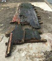 京都府京丹後市丹後町間人の漁港で見つかった木造船の残骸とみられる木片=昨年11月23日(舞鶴海上保安部提供)