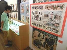 大人向けに描かれた明治時代の風刺マンガ雑誌を紹介する展示(京都市中京区・京都国際マンガミュージアム)
